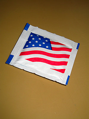 Sugar packet showing American flag - p1072m2157568 by Neville Mountford-Hoare