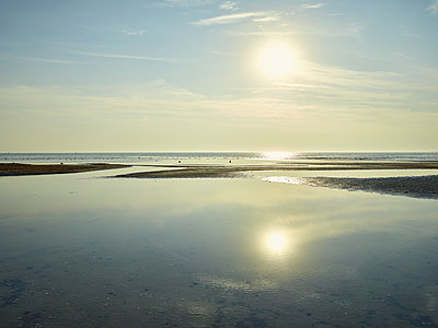 Beach with sunrise - p1200m1131557 by Carsten Goerling