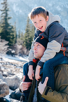 Boy on Father's Shoulders - p1262m1194772 by Maryanne Gobble