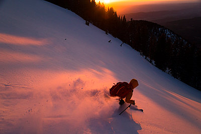 Brody Leven Skiing Down La Sal Mountains During Sunset In Utah - p343m1218003 by Adam Clark
