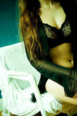 Woman with underwear - p4130011 by Tuomas Marttila