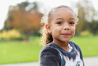 Portrait confident, smiling girl - p1023m2161218 by Tom Merton