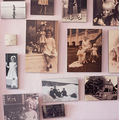 Display of old family photographs - p349m809006 by Emma Lee