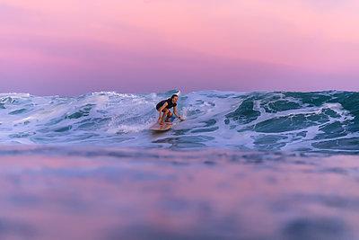 Woman surfing in sea - p343m2010756 by Konstantin Trubavin