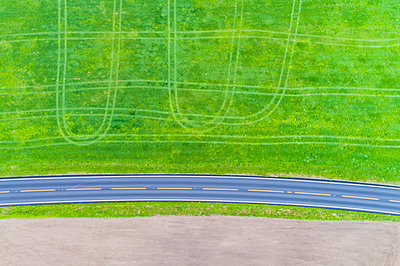Aerial view of country road and green field - p312m1557974 by Johner