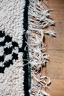 Black and white carpet with fringes - p1621m2254266 by Anke Doerschlen