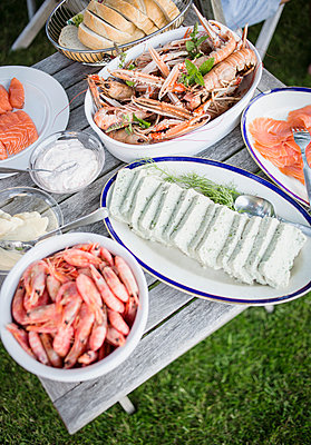 Table With A Buffet Of Seafood And Baguette, Sweden  - p847m1529320 by Kamilla Kraczkowski