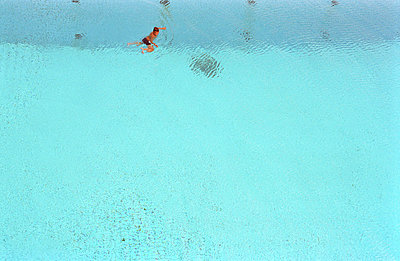Swimming in a pool in the summer - p1260092 by Combifix