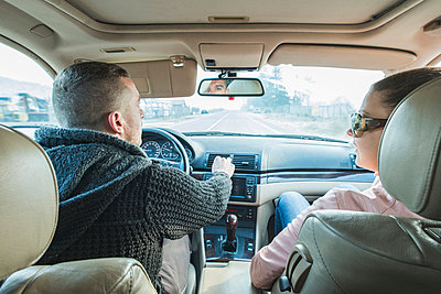 Couple traveling in car - p300m998502f by Deyan Georgiev