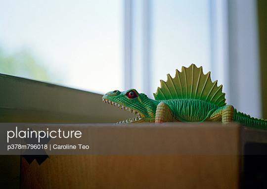 Green plastic dinosaur - p378m796018 by Caroline Teo