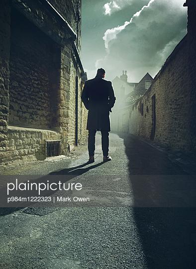 Man in alley - p984m1222323 by Mark Owen