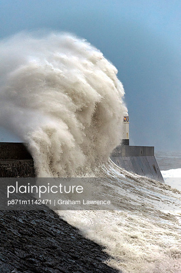 Huge waves crash against the harbour wall at Porthcawl, Bridgend, Wales, United Kingdom, Europe - p871m1142471 by Graham Lawrence