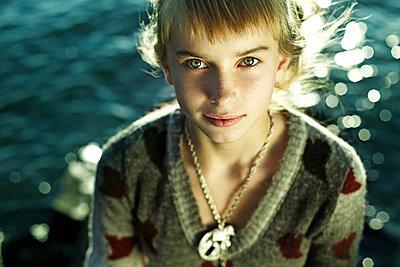 Caucasian girl sitting by water - p555m1478492 by Vladimir Serov