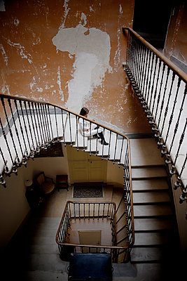 Woman in the stairwell of a castle - p1105m2245459 by Virginie Plauchut