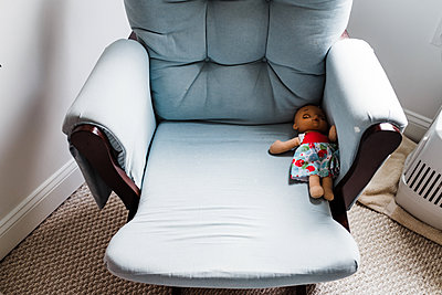 Doll left behind on chair - p1166m2131119 by Cavan Images