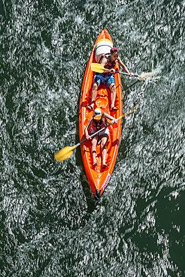 Paddling a canoe - p1292m1169362 by Niels Schubert