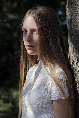 Teenage girl with long hair - p1540m2122832 by Marie Tercafs