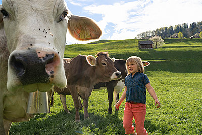 Girl with cows on pasture - p300m2114147 by Francesco Buttitta