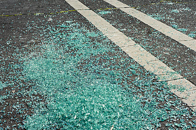 Broken Glass on Ground in Parking Lot - p1166m2095260 by Cavan Images