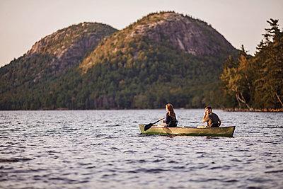 Couple canoeing in Jordan Pond, Acadia National Park, Maine, USA - p1166m2202302 by Chris Bennett