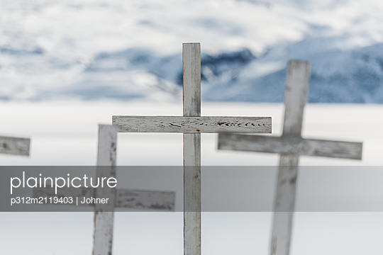 Wooden crosses at winter - p312m2119403 by Johner