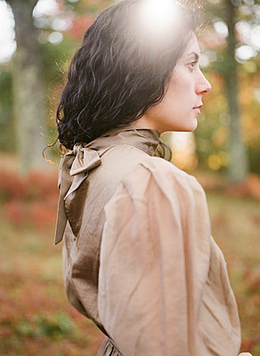 Analog film fashion portrait of woman profile side of face in dress - p1166m2236589 by Cavan Images