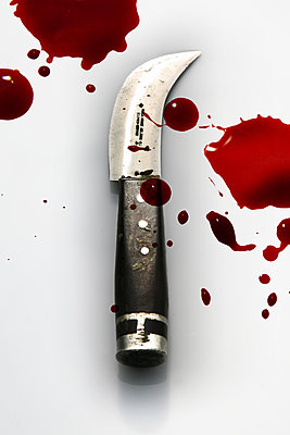 Blood drops beside putty knife - p1038m2087591 by BlueHouseProject