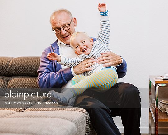 Fooling around with grandpa - p606m2178636 by Iris Friedrich