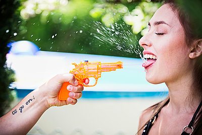 Splashing withe the water gun - p1149m1590645 by Yvonne Röder