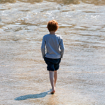 Walking away - p1245m1043414 by Catherine Minala