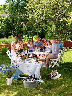 Family having party in garden - p31228720 by Per Magnus Persson