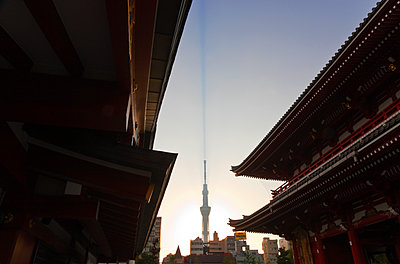 Tokyo Skytree, the world's tallest free-standing broadcast tower at 634 meters, is seen at dawn from Sensoji Temple in the Asakusa district, located in Taito Ward of the old shitamachi downtown area in Tokyo, Japan. - p855m1122261 by Ben Simmons