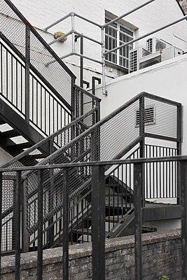 Fire escape stairway muddle - p1048m1506362 by Mark Wagner