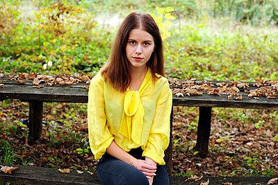 Teenage girl wearing yellow blouse - p1412m2128864 by Svetlana Shemeleva
