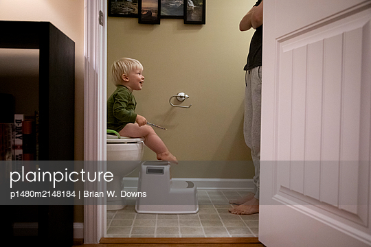 Portrait of a young boy potty training and his Mother watching - p1480m2148184 by Brian W. Downs