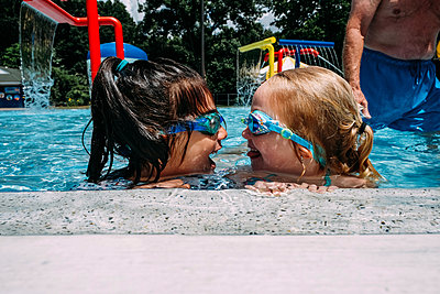 Happy friends in swimming pool at resort - p1166m1489634 by Cavan Images