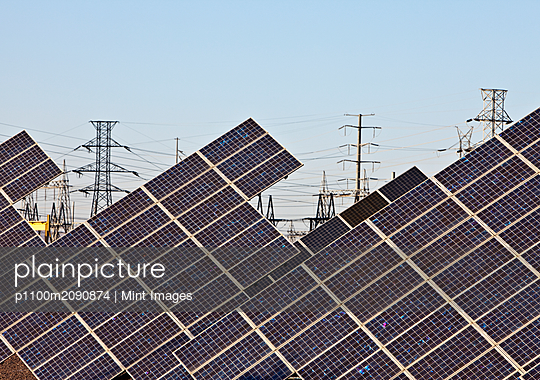 Solar Panels and Power Lines - p1100m2090874 by Mint Images