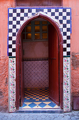 Ornate arched doorway with tiles - p429m768792f by Henglein and Steets
