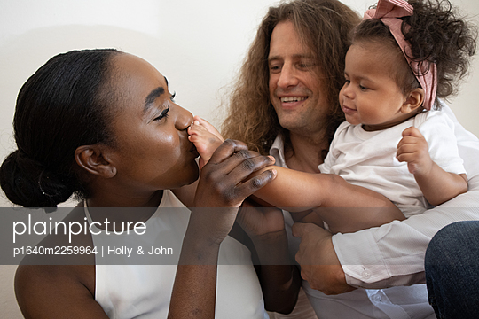 Multi ethnic family with toddler girl - p1640m2259964 by Holly & John