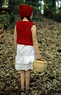 Girl with basket in a forest - p1570198 by Claudia Huber