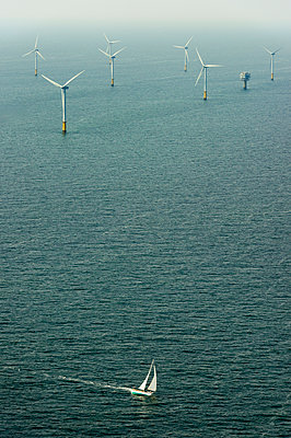 Sailing boat and offshore windfarm - p1132m1591239 by Mischa Keijser