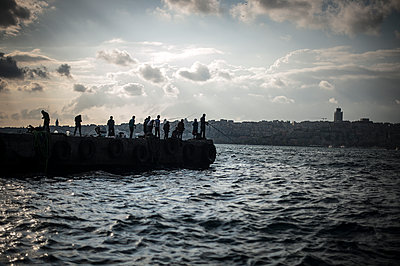Fishermen on a seawall - p1007m1134829 by Tilby Vattard