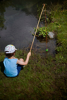 Young boy fishing with a plastic hook, Hautes-Pyrénées, France - p1028m2108529 by Jean Marmeisse
