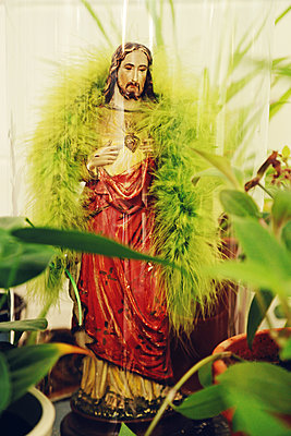Statue of Jesus with plants - p1540m2100923 by Marie Tercafs