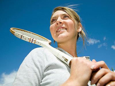 Girl with badminton racket - p4264880f by Tuomas Marttila