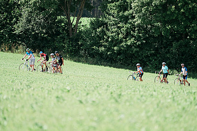 Group of racing cyclists in the meadow - p1437m2253430 by Achim Bunz