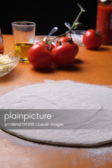 homemade pizza base ready to make at home - p1166m2191995 by Cavan Images