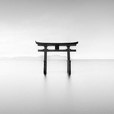 Long exposure shot of Shirahige shrine Torii gate at sunrise, Lake Biwa, Shiga Prefecture, Japan - p1166m2201371 by Cavan Images