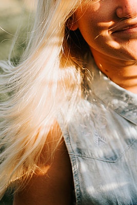 Woman with blonde hair enjoying sunlight - p1507m2172036 by Emma Grann