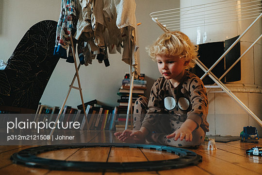 Boy playing - p312m2121508 by Johner